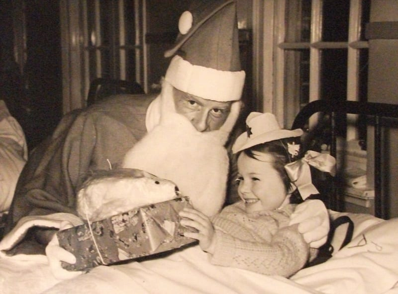 Christmas 1955 – Santa (Dr Sawyer) with patient