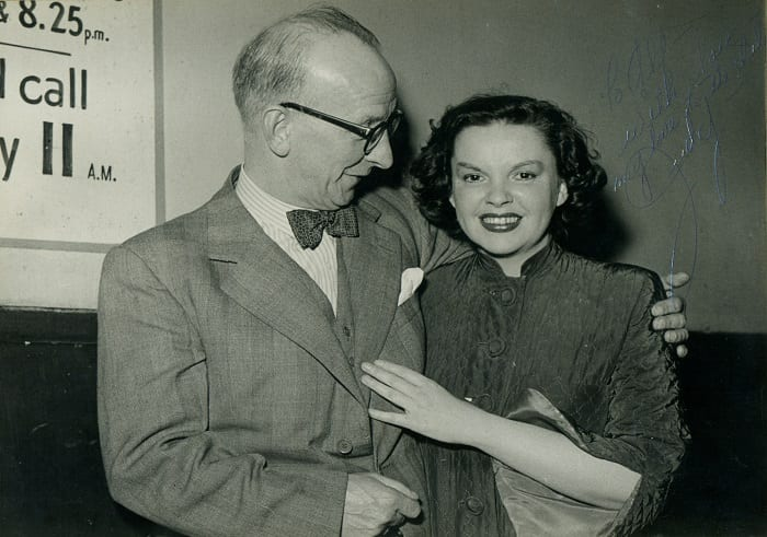 A signed photograph of Mr Alfred Ellsworth with Judy Garland