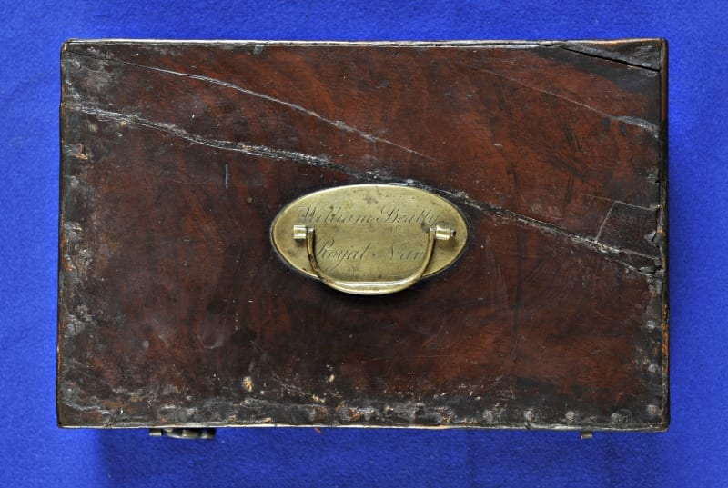 """Top of Beatty's wooden case of instruments. The brass plaque is inscribed """"William Beatty, Royal Navy""""."""