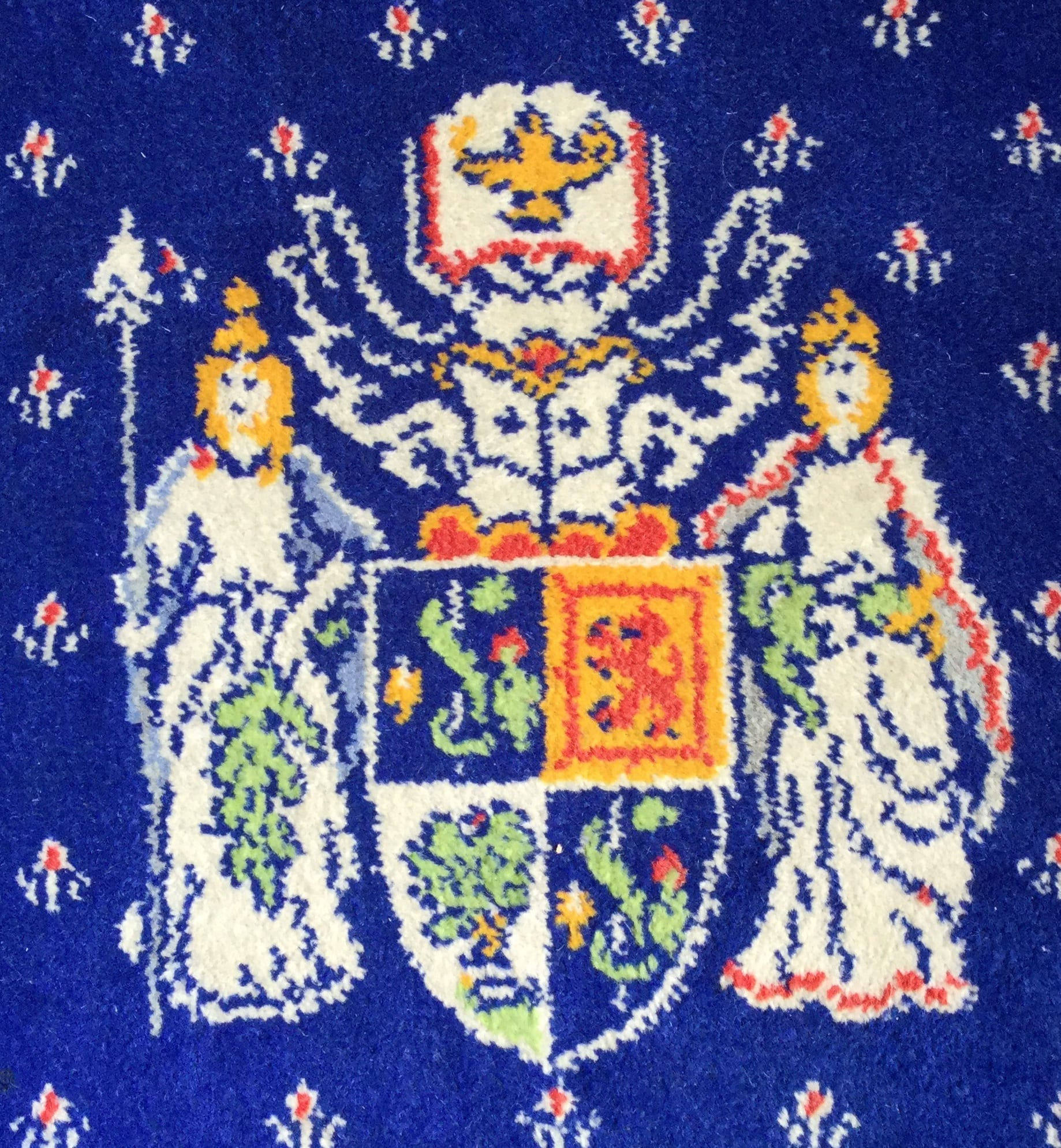 Logo of the College featured on the Lock Room carpet