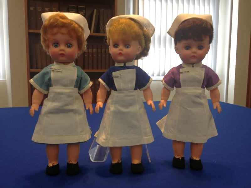 Dolls wearing Queen Mother's Hospital uniforms, 1964