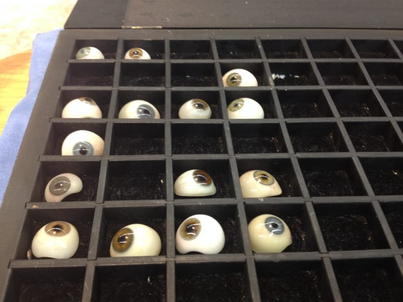 Glass eyes manufactured by Lizars, Glasgow. On loan from Black & Lizars optometrists.